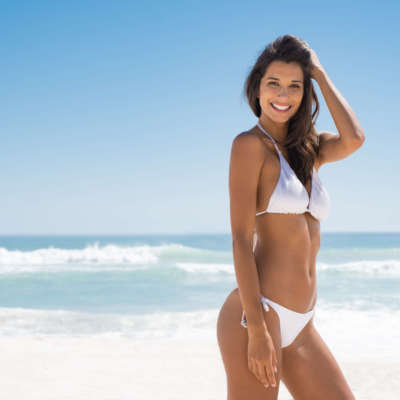 beautiful woman on the beach with perfect body after Posh Body Slim Body contouring